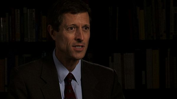 Dr. Neal Barnard headshot dark background