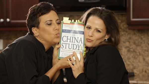 The Chef and The Dietitian holding The China Study book
